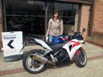 Caroline with her bike loaned for the weekend
